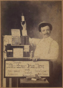 old photo of traveling salesman offering medicines