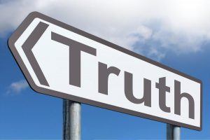Highway arrow reading 'TRUTH'